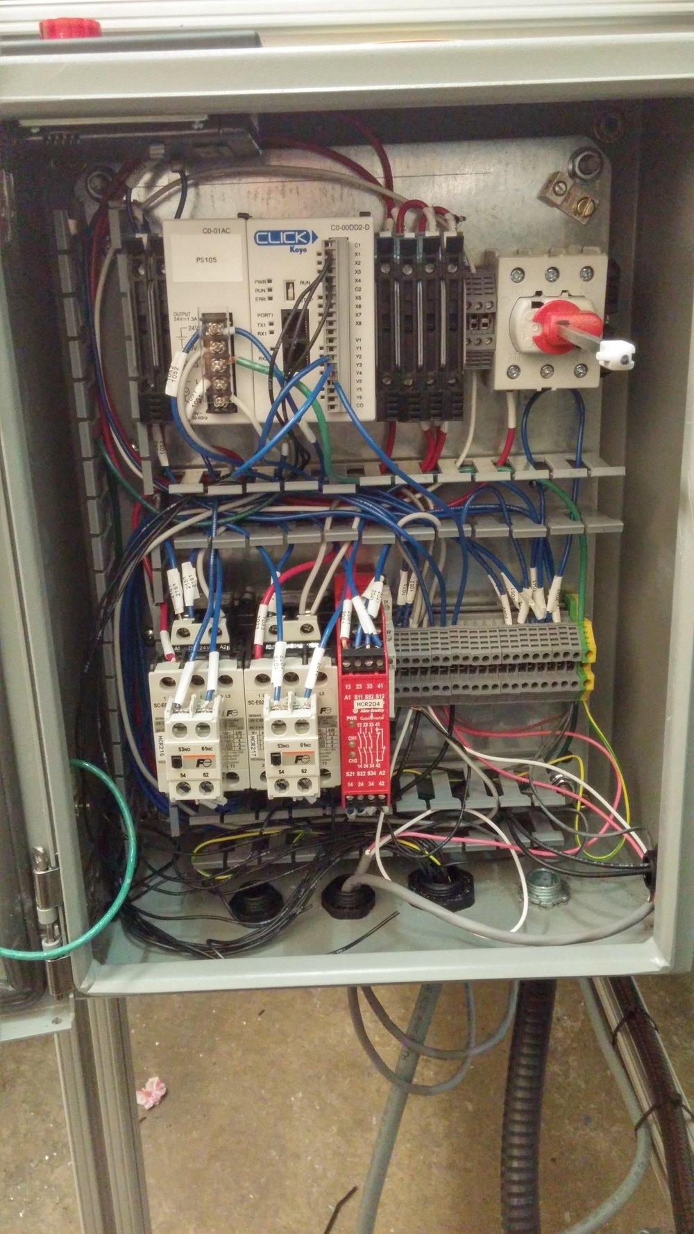 Control box , I/O controller programmed with ladder logic
