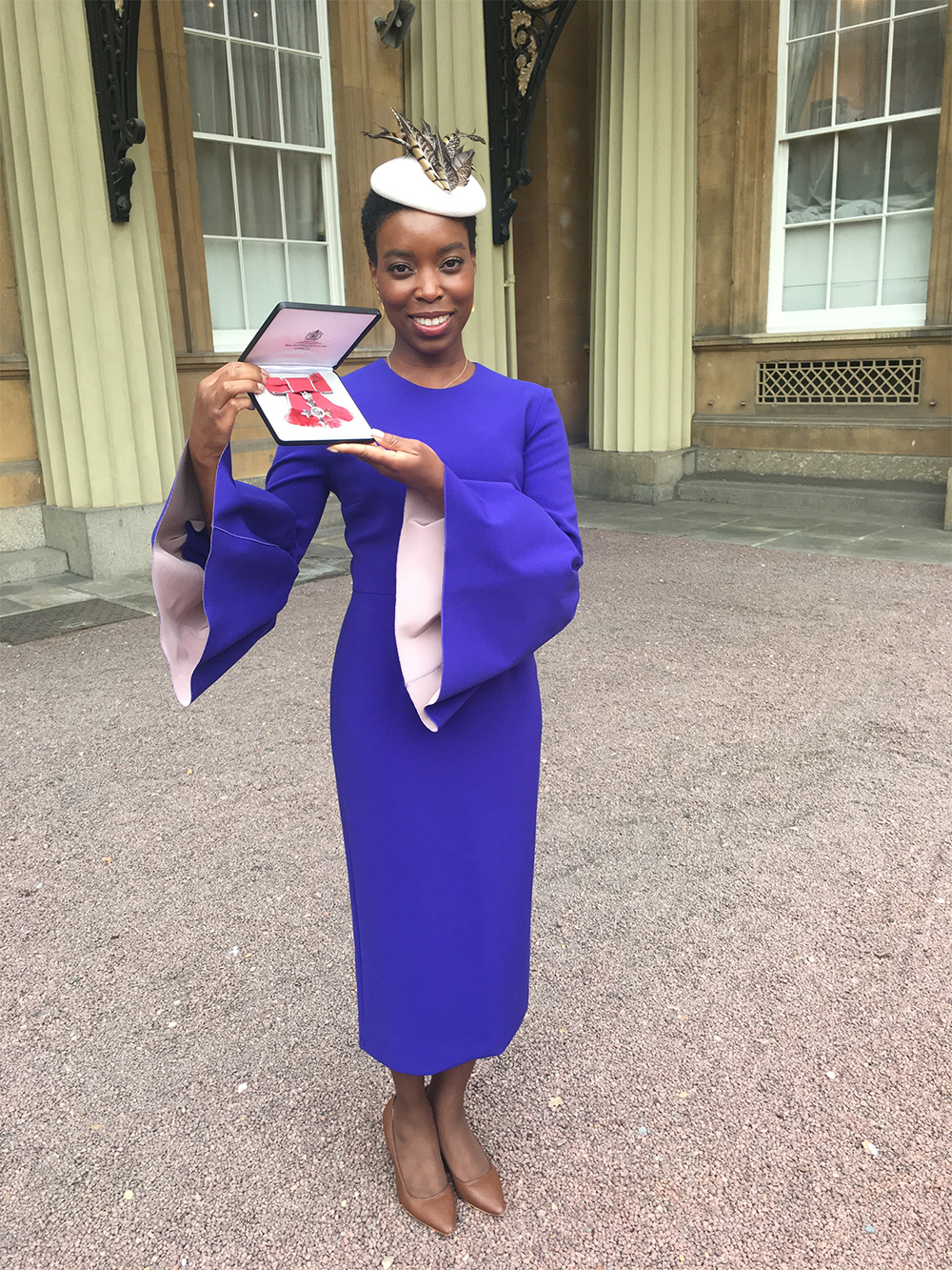 Ade Hassan MBE Award at Buckingham Palace