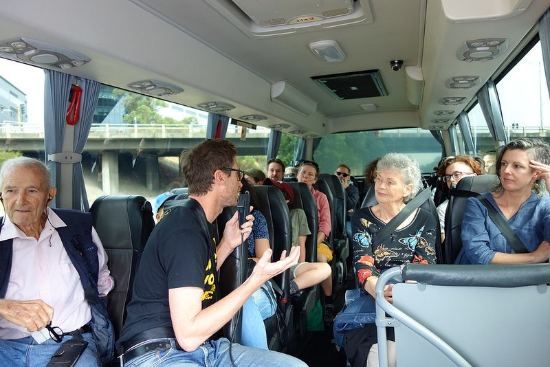 Allan Yeomans (left) and Lucas Ihlein introducing their work in soil, farming, and socially engaged art on the bus trip to Hallora.
