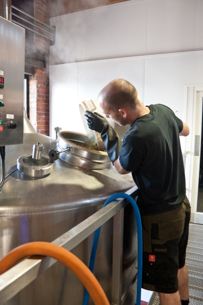 Gary Walters adding aroma hops Source: The Ludlow Brewing Company