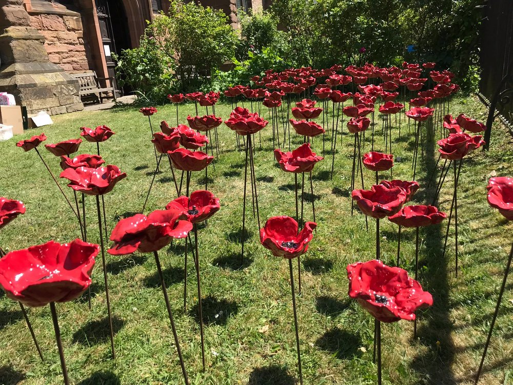The beautiful garden of poppies at St Laurence's Church, Ludlow