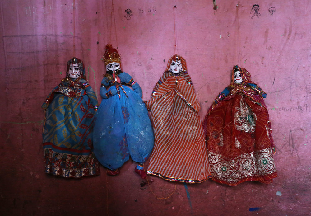 Rajasthani puppets are pictured in the home of a puppet maker Ghita Devi in the Kathputli slum colony of New Delhi, India, December 8th, 2014. Ghita is one of 40,000 people living in the slum, which is popularly known for being the worlds largest colony of street performers, including magicians, snake charmers, acrobats, singers, dancers, actors, traditional healers and musicians and puppeteers. Their livelihood is under threat however as the Delhi government has obtained contracts to demolish the colony to make way for developers to build high-rise apartments.