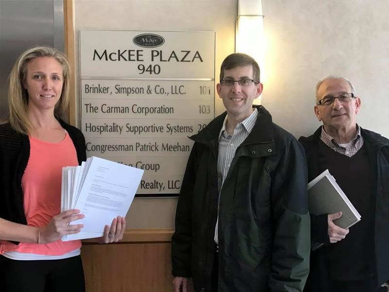 H-CAN members hand delivering letters from the group to former Congressman Meehan's office.