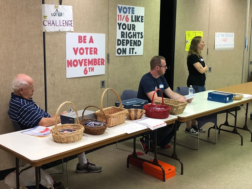 Members of H-CAN's Indivisible action group at the voter registration tables at the September 16, 2018 H-CAN monthly meeting.