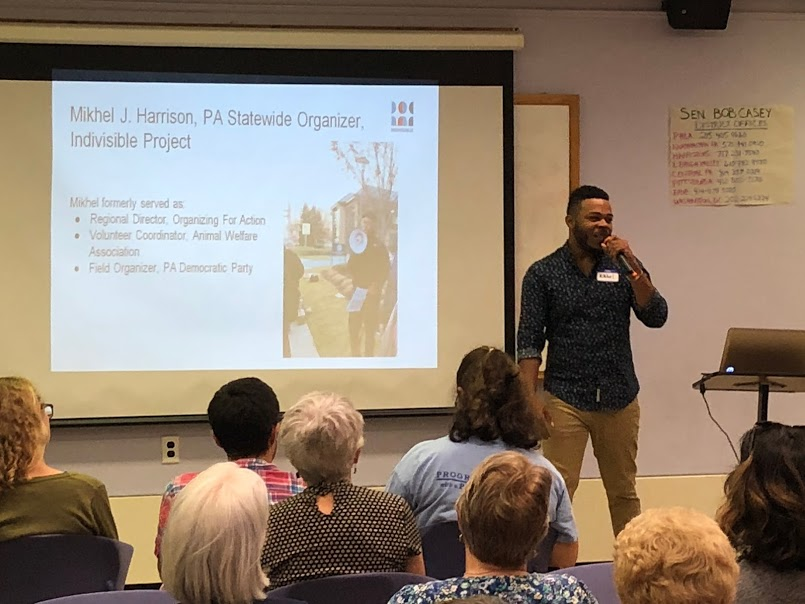 Mikhel Harrison from Indivisible PA speaking to a packed audience at the September 16, 2018 H-CAN monthly meeting.
