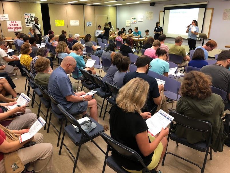 "A packed audience taking the ""Be a Voter!"" challenge at the September 16, 2018 H-CAN monthly meeting."