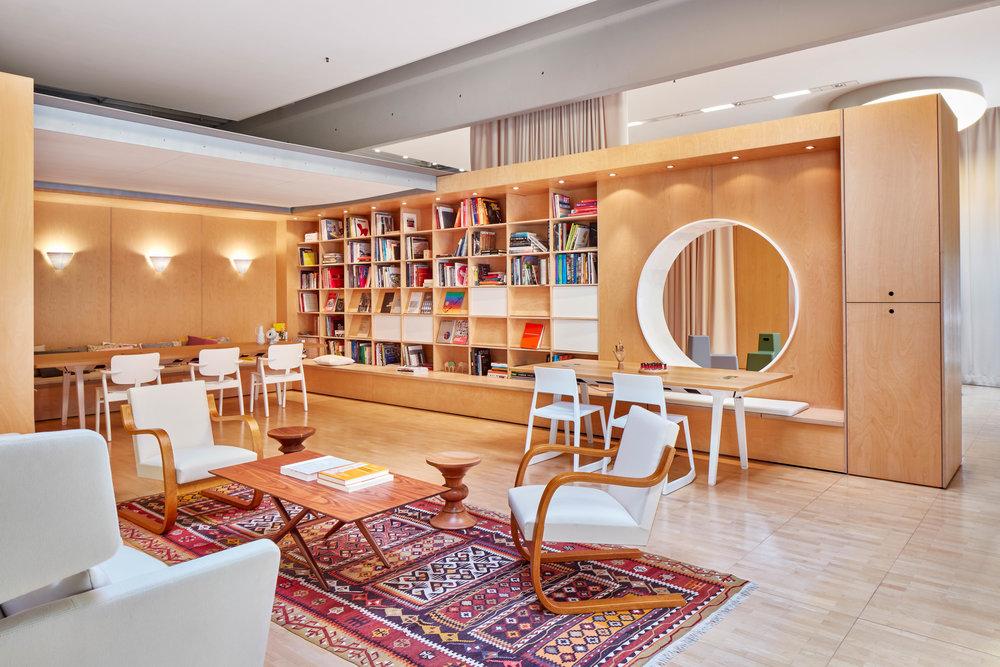 Rückzugsort wie Bibliotheken erhöhen die Arbeitsqualität eines Unternehmens. Hier ein Entwurf von Vitra