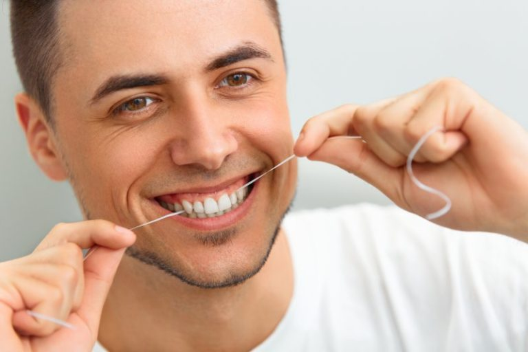on Learn How an Implant-Supported Denture Can Change Your Life! Can Flossing Improve My Oral Health? Your Lincoln Dentist Weighs in .jpg