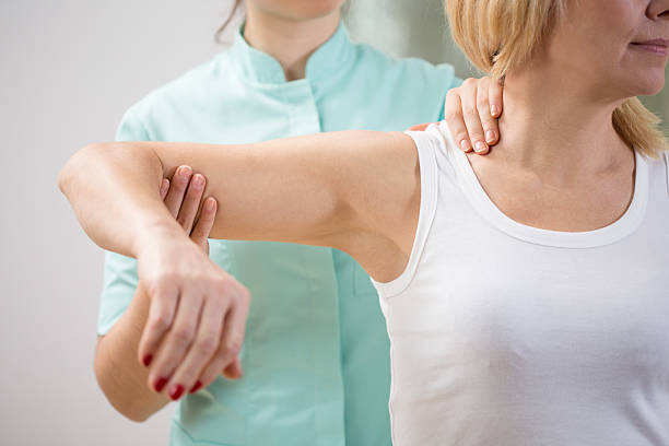Are you tired of shoulder pain when reaching or lifting? - Click HERE for physical therapy treatments for your shoulder pain
