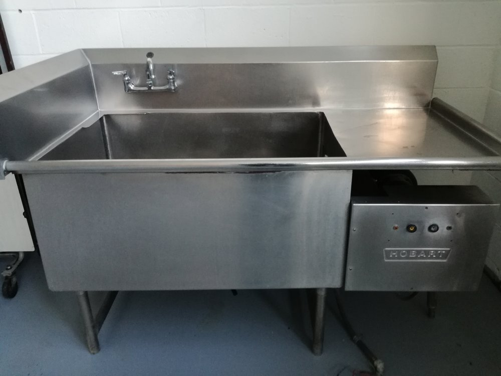 Hobart Turbo WashPowered Sink. $2,500  - Excellent pot washing/soaking sink. This is a large SS unit made by Hobart. Motor condition is unknown, we have not tested it. 3 phase large motor.  Make short work on cleaning pots, pans, car parts, electronics, clean whole hogs, deer meat, anything you want to clean. Comes with stainless steel faucet.  Heavy duty sink!!  Don't miss this. Measures  34 in deep by 5 ft 5 in wide. The bowl measures 28 in Deep by 42 in Long and it's depth is 18 in.