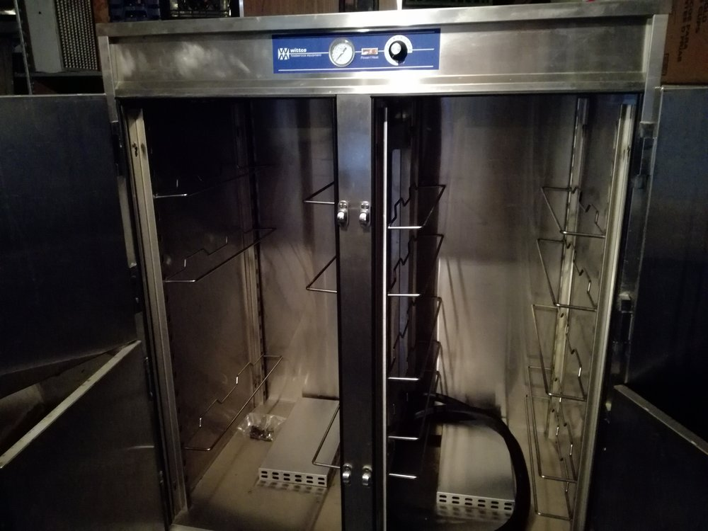 NEW Wittco  Hot Holding Cabinet. $1200.00 - Brand new, never used Wittco food holding cabinet. This unit is new. It was never used. Well build stainless steel cabinet on heavy duty casters. Easy access with 4 individually opening doors.   Unit can be adjusted up to 220F (105c) with the turn of a button.  8 racks are included, but more can be added. Unit will hold full size or half size pans or sheet trays. Will support 21 shelves per side.  Unit is electric 220v with a 30 amp plug. Excellent shape, and has wheels for easy mobility. Great for a caterer or kitchen. Units weight and measurements available.