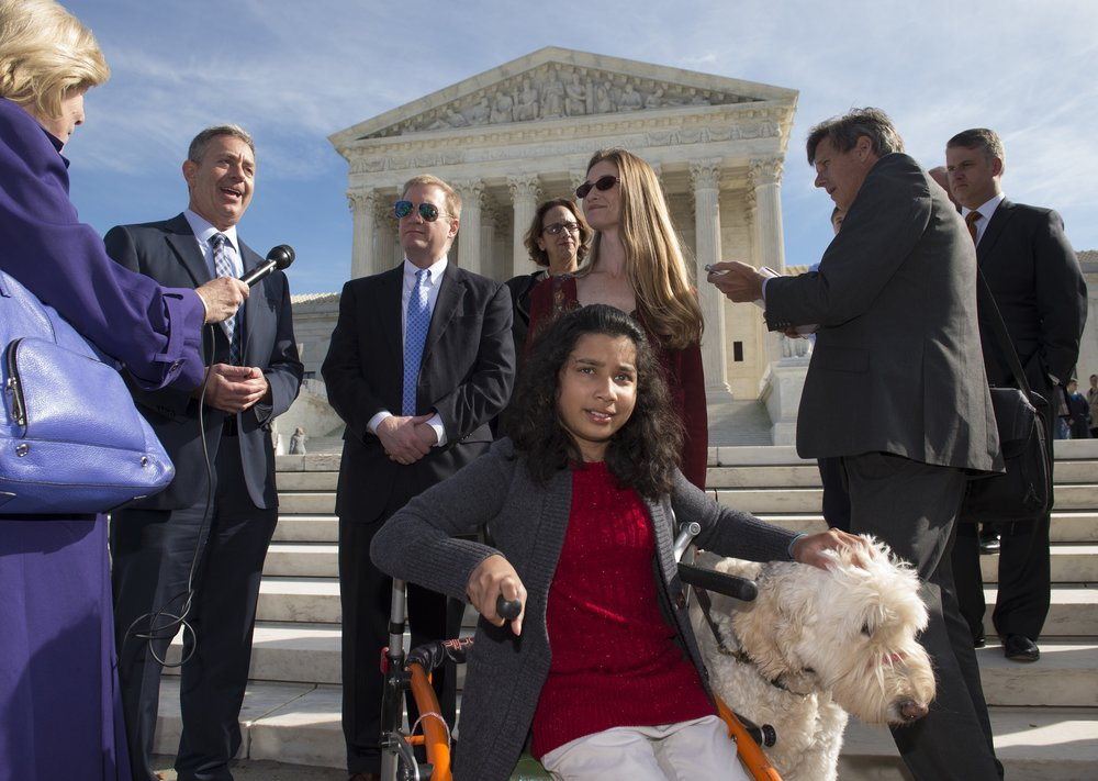 Sam with Ehlena Fry and her dog, Wonder, outside of the Supreme Court.