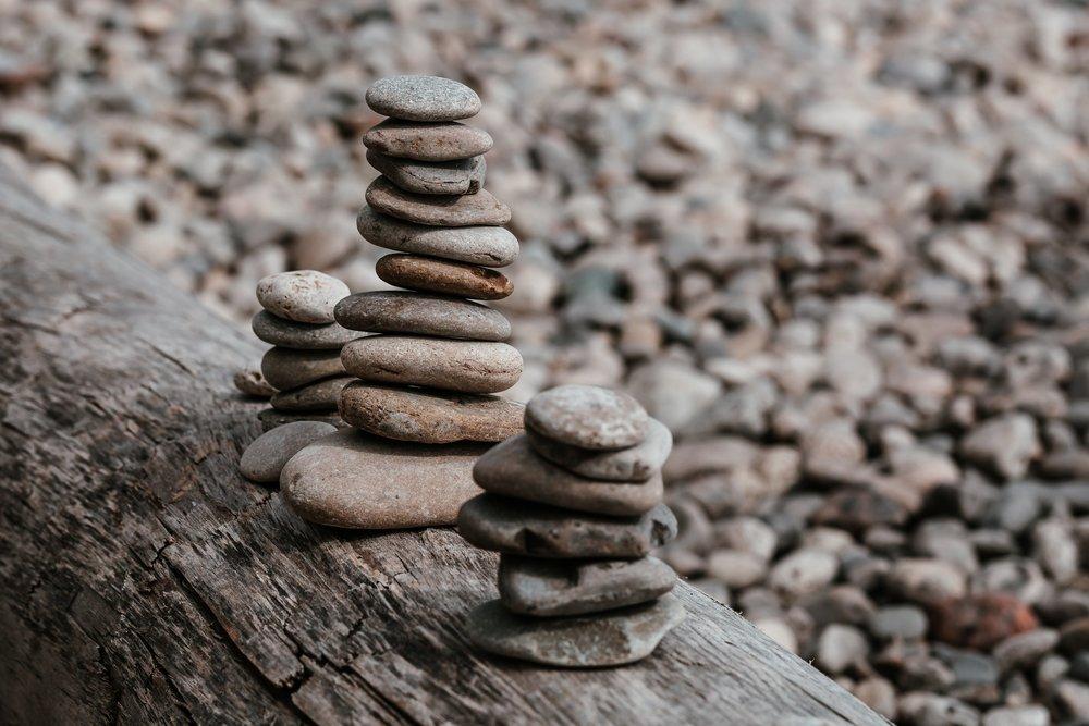 small-rock-piles-on-log_4460x4460.jpg