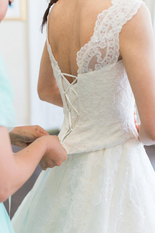 bride-stepping-into-dress.jpg