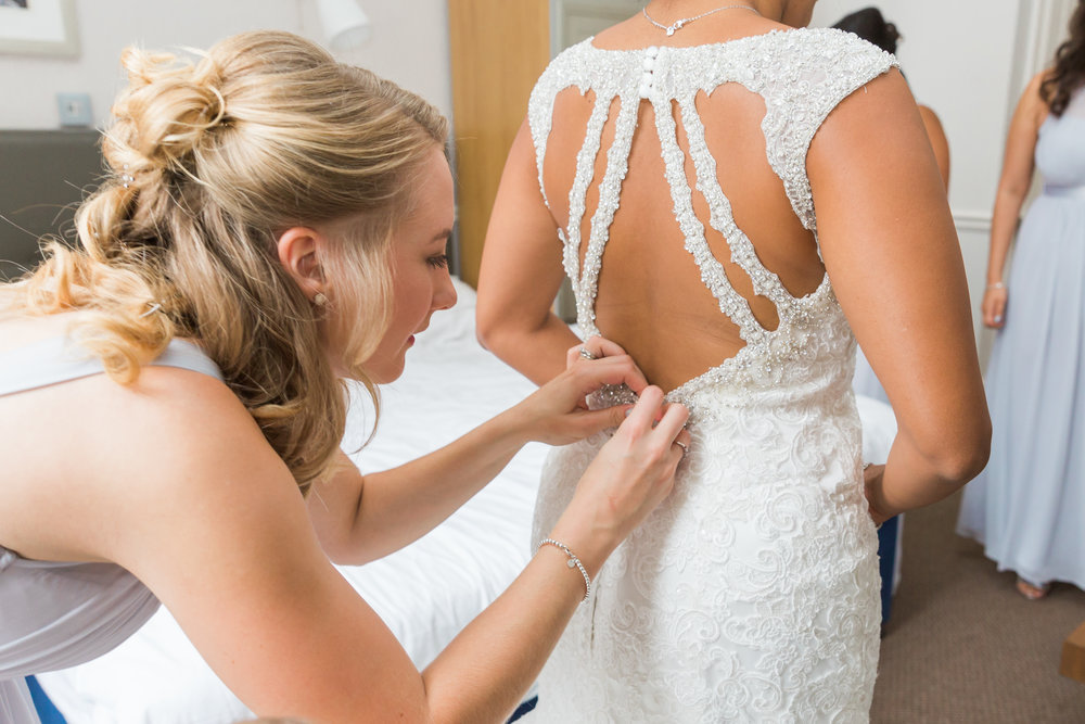 bride-stepping-into-dress.jpg