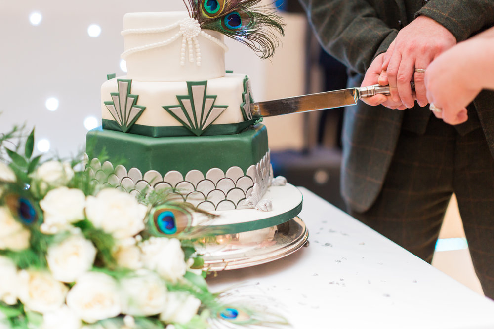 vintage wedding cake with peacock feathers.jpg