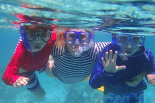Hayden and her boys snorkeling in the Maldives.