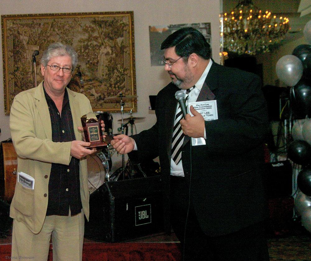 P. Riegert acceptng award from Nelson.jpg