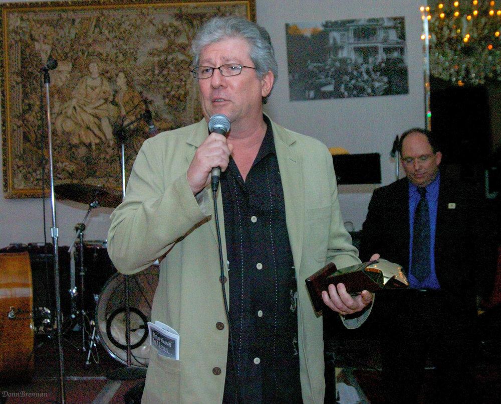 P.Riegert w award in hand 3.jpg