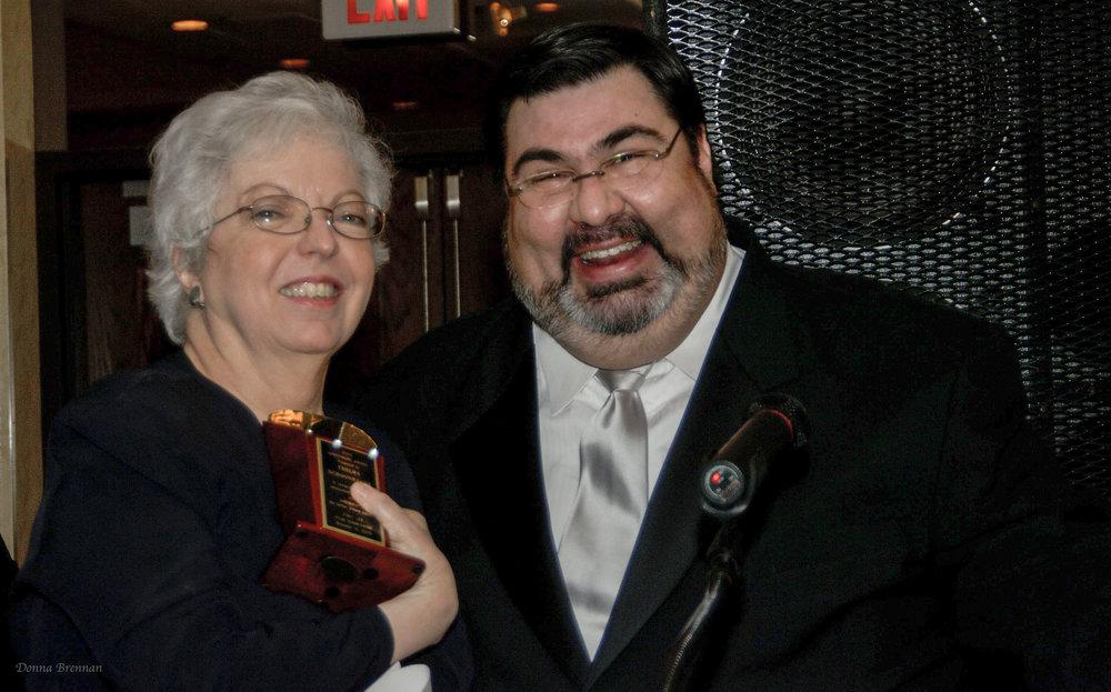 Thelma holding award & Nelson.jpg