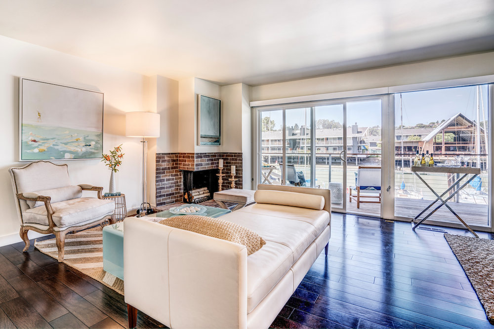 The Cove at Tiburon apartment homes offer floor-to-ceiling windows, wood-buring fireplaces and private balconies