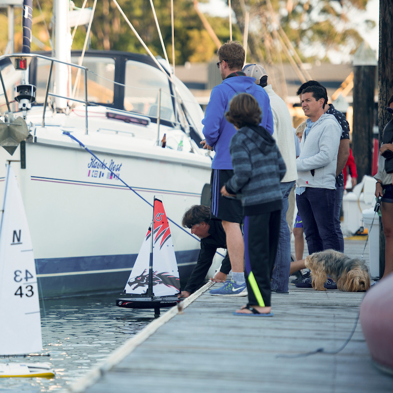 The Cove at Tiburon residents enjoy a remote control sailboat regatta in the private marina.