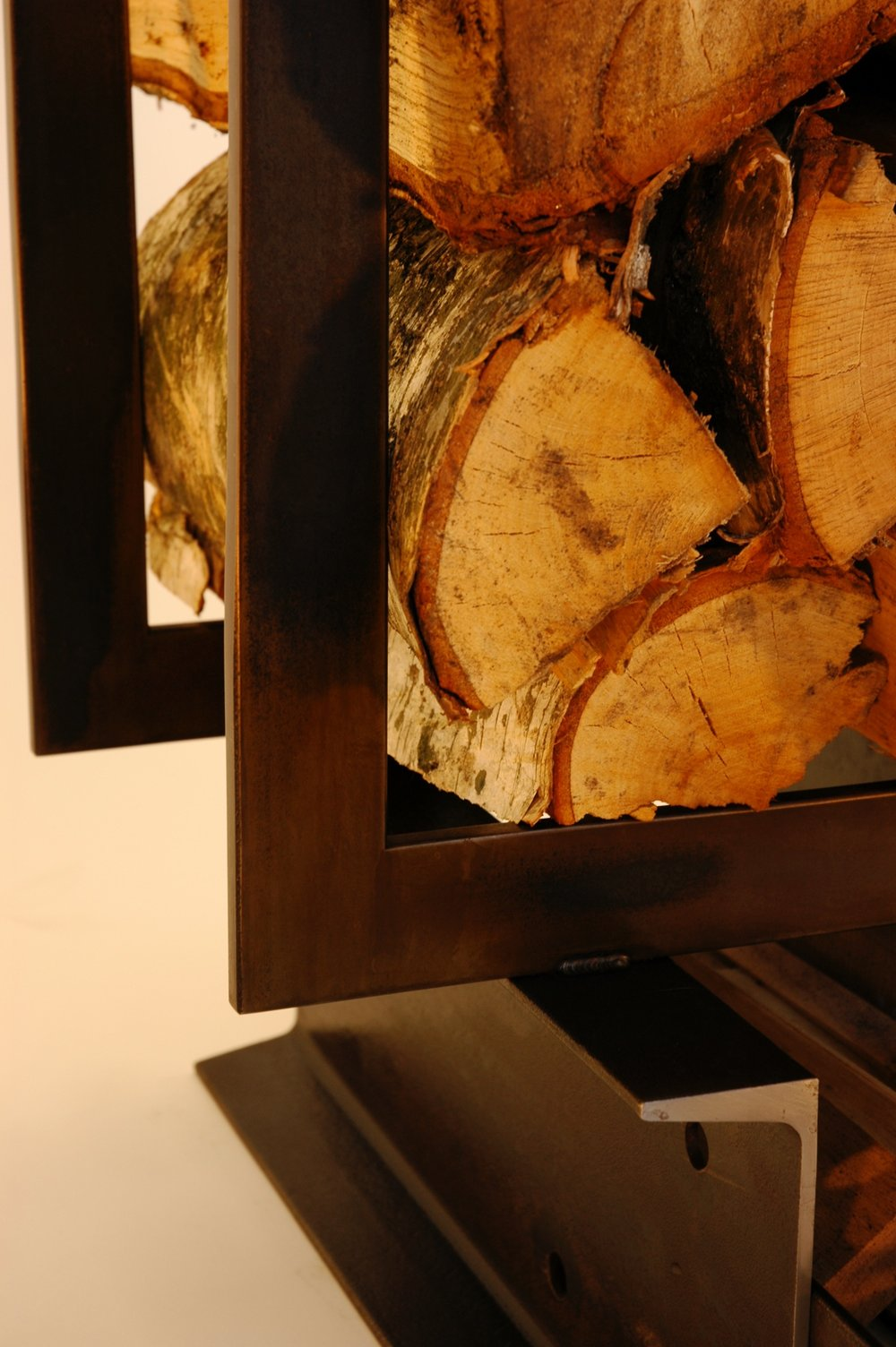 "LOG TRUCK: This wood and kindling holder was fabricated from hot rolled steel flat bar and ""C"" channel. Brown/black patina."