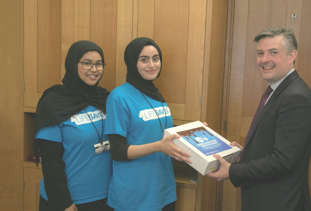 Jon Ashworth receives his Cake4Syria supporting Islamic Relief's campaign to save lives in Syria - Wednesday June 6 2018