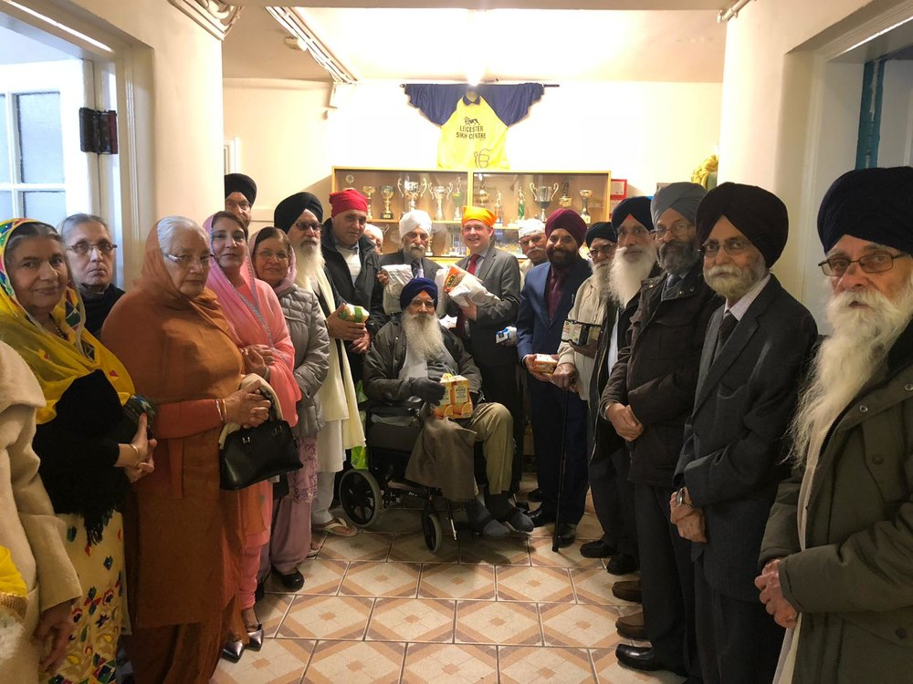 Jon Ashworth, along with Councillor Gugnani, accepts the generous donation to the Highfields Food Bank from Guru Amar Das Gurdwara - Friday November 23 2018