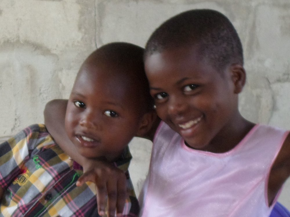 Two smiling students from the Quentin Junior Academy in Tanzania