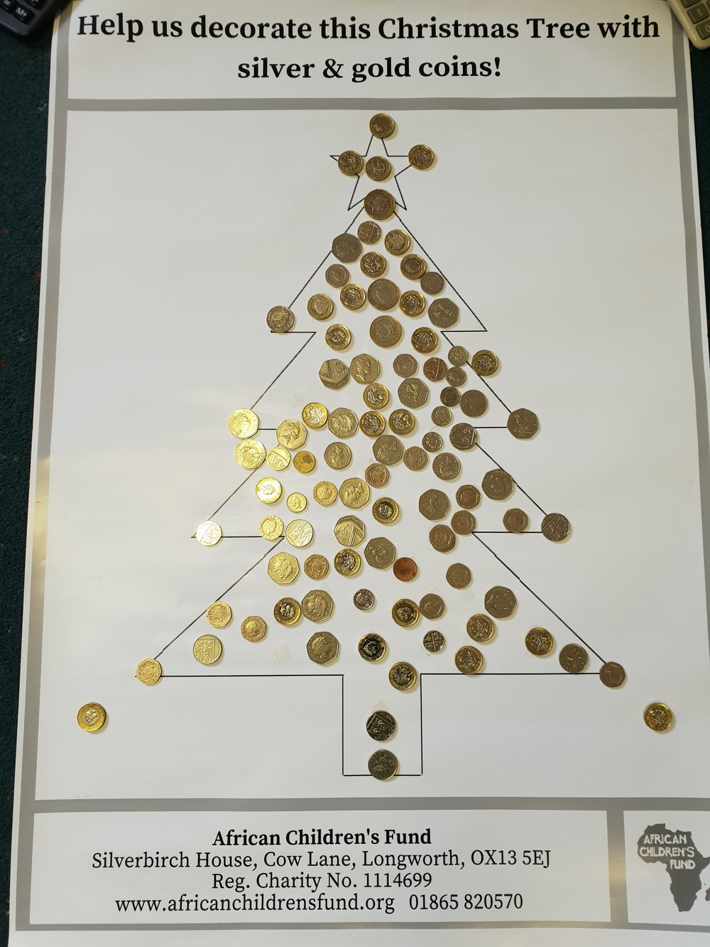 Giant Christmas tree poster with coins attached, decorated by Burford Primary School.