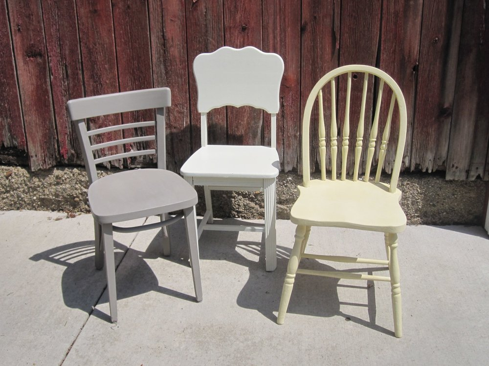 Wood Chairs - Description ~ variety of neutral painted chairs that can be used for the head table or other seatingQuantity ~ 30Rental Price ~ $4 each