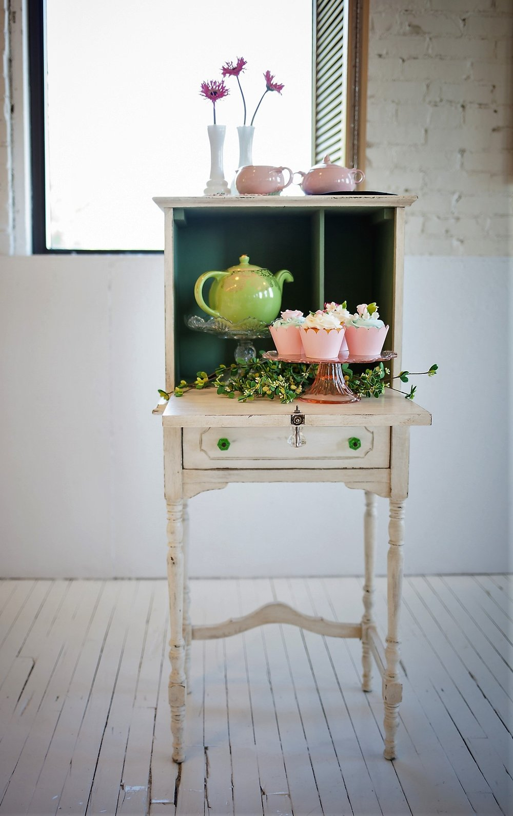 Chelsea Child's Desk - Description ~ sweet little desk with a fold down front door that can function as a guest book table, simple display or to serve a tea party!Quantity ~ 1Rental Price ~ $35