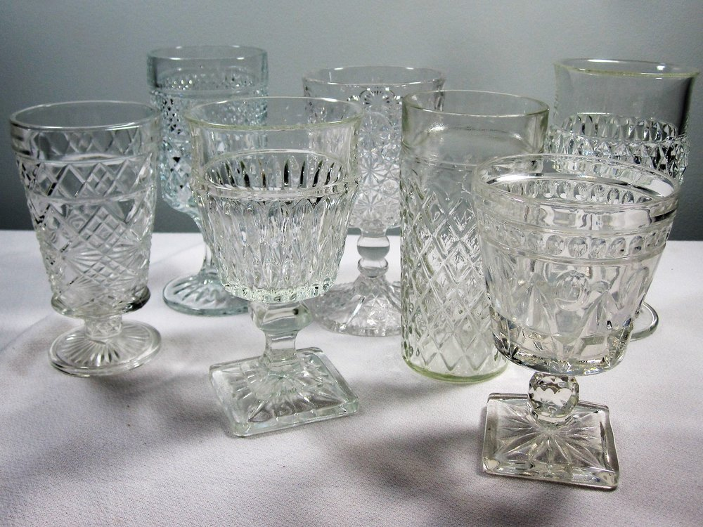 Clear Drinkware - Description ~ an assortment of pressed glass cups add an elegant look to your table.  Who doesn't prefer real glass on their lips as opposed to plastic??Quantity ~ 220Price ~ .50