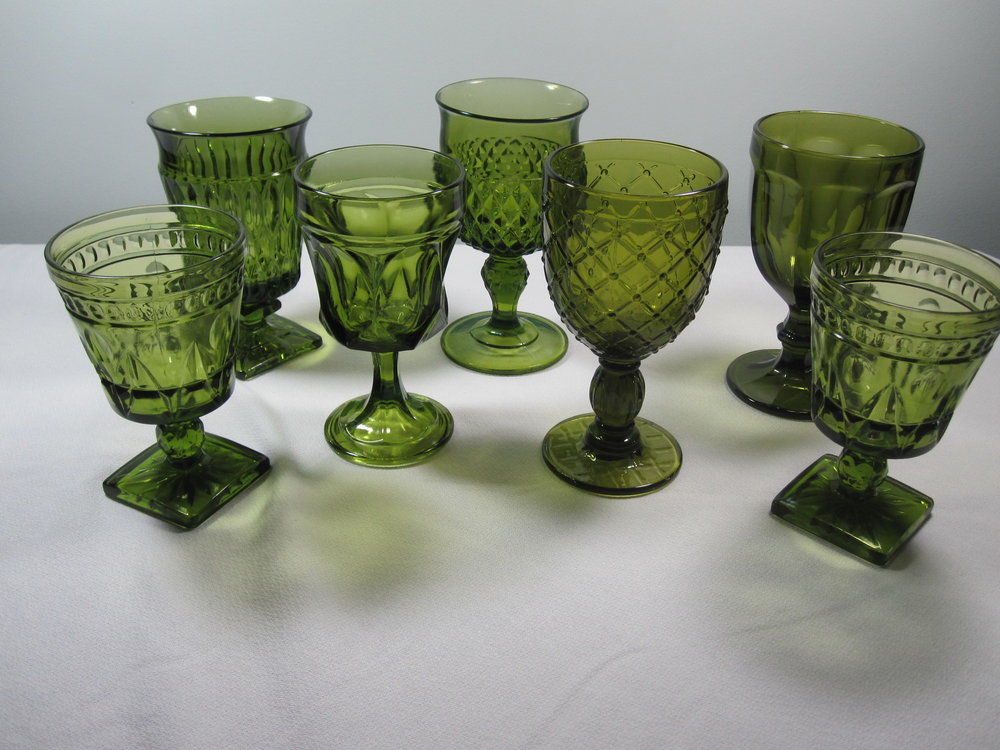 Green Drinkware - Description ~ Assorted green glass styles look lovely beside the china place setting.Quantity ~ 50Price ~ $1