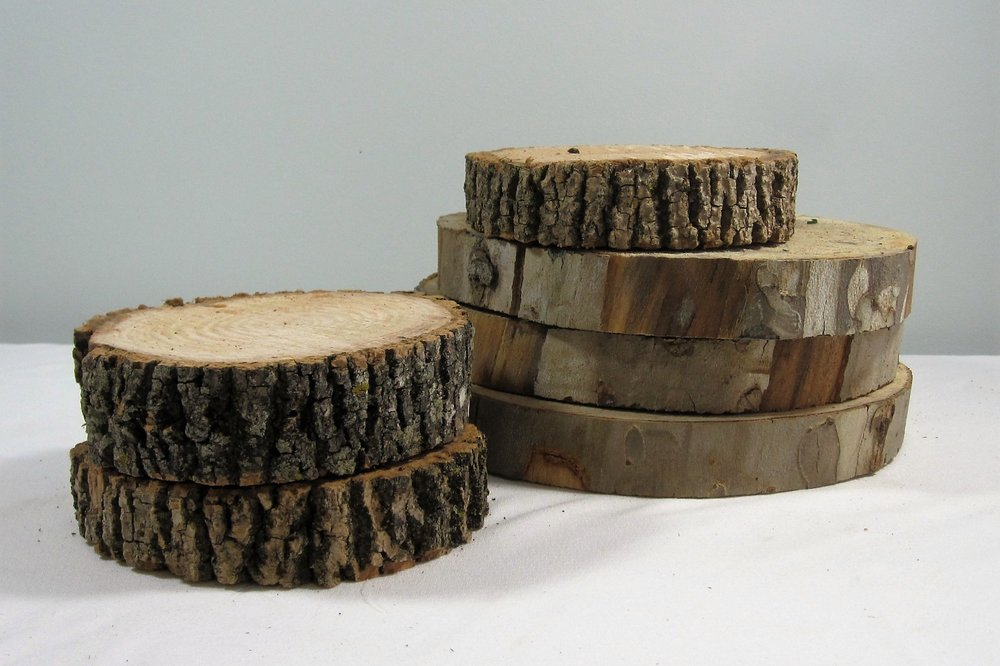 Wood Rounds - Description ~real tree rounds in a variety of sizes make great bases for centerpieces. Some are even large enough to hold the cake!Quantity ~ manyPrice ~ $1 - $6