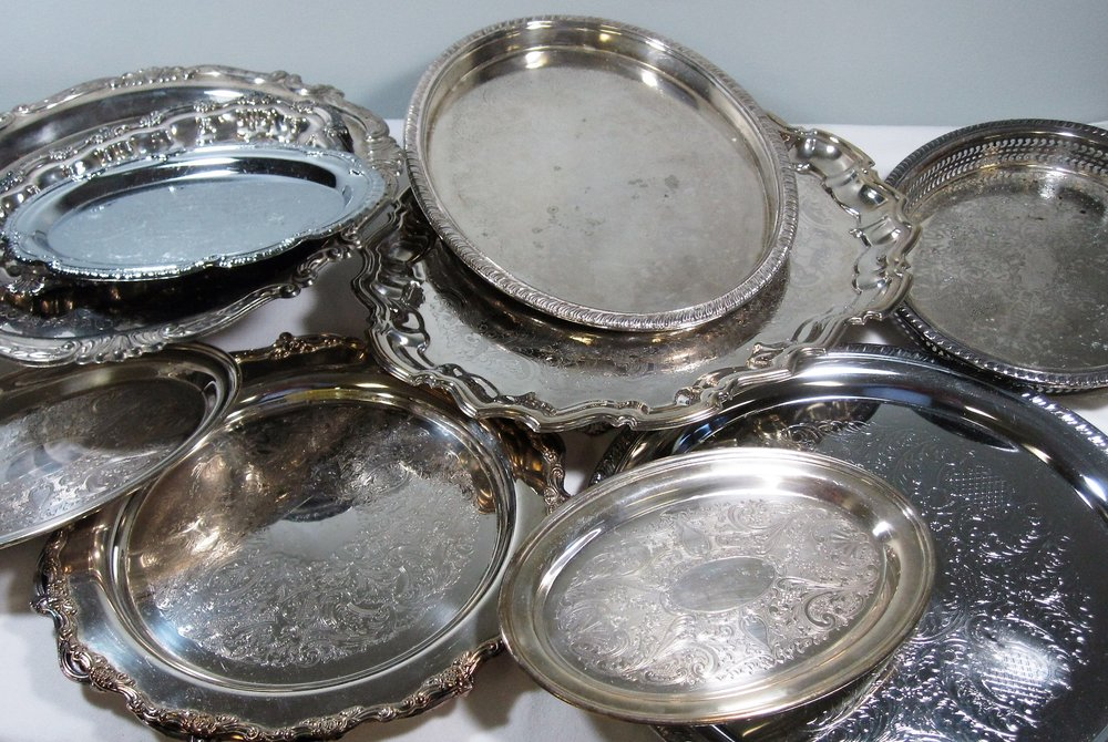 Silver Trays - Description ~ variety of shapes & sizes , many with a vintage patina. Use as a centerpiece base or for food serviceQuantity ~ 17 oval, 11 round, 4 squarePrice ~ $1-$4