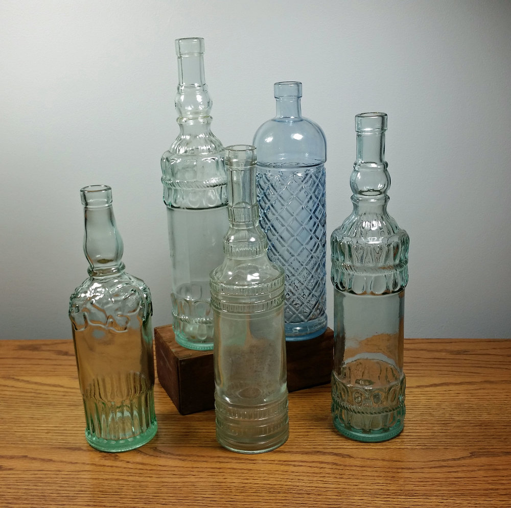 "Bottles - Description ~ tall decorative bottles in a variety of heights from 10"" - 14""Quantity ~ 24+Price ~ $1-$2"