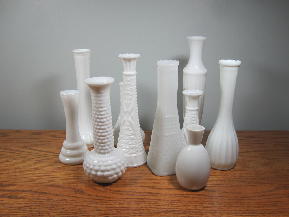 "Milk Glass Vases - Description ~ varied heights from 5""-11""Quantity ~ 50Price ~ $1-$2"