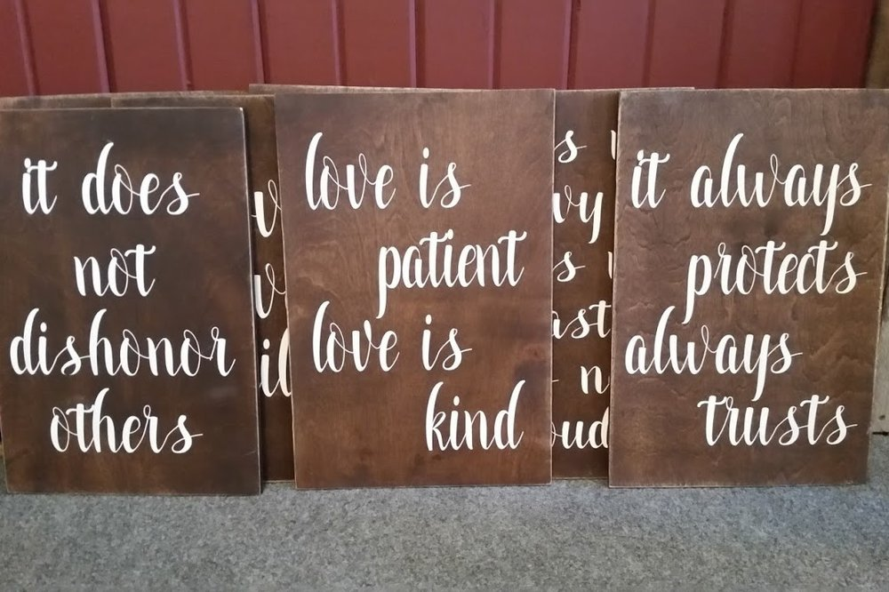 """Love is"" signs - Description ~ set of 8 tiles that display the verses in the I Corinthians 13 ""love chapter"". They work well placed along the aisle or in other settings as well.Quantity ~ 1 setRental Price ~ $30"