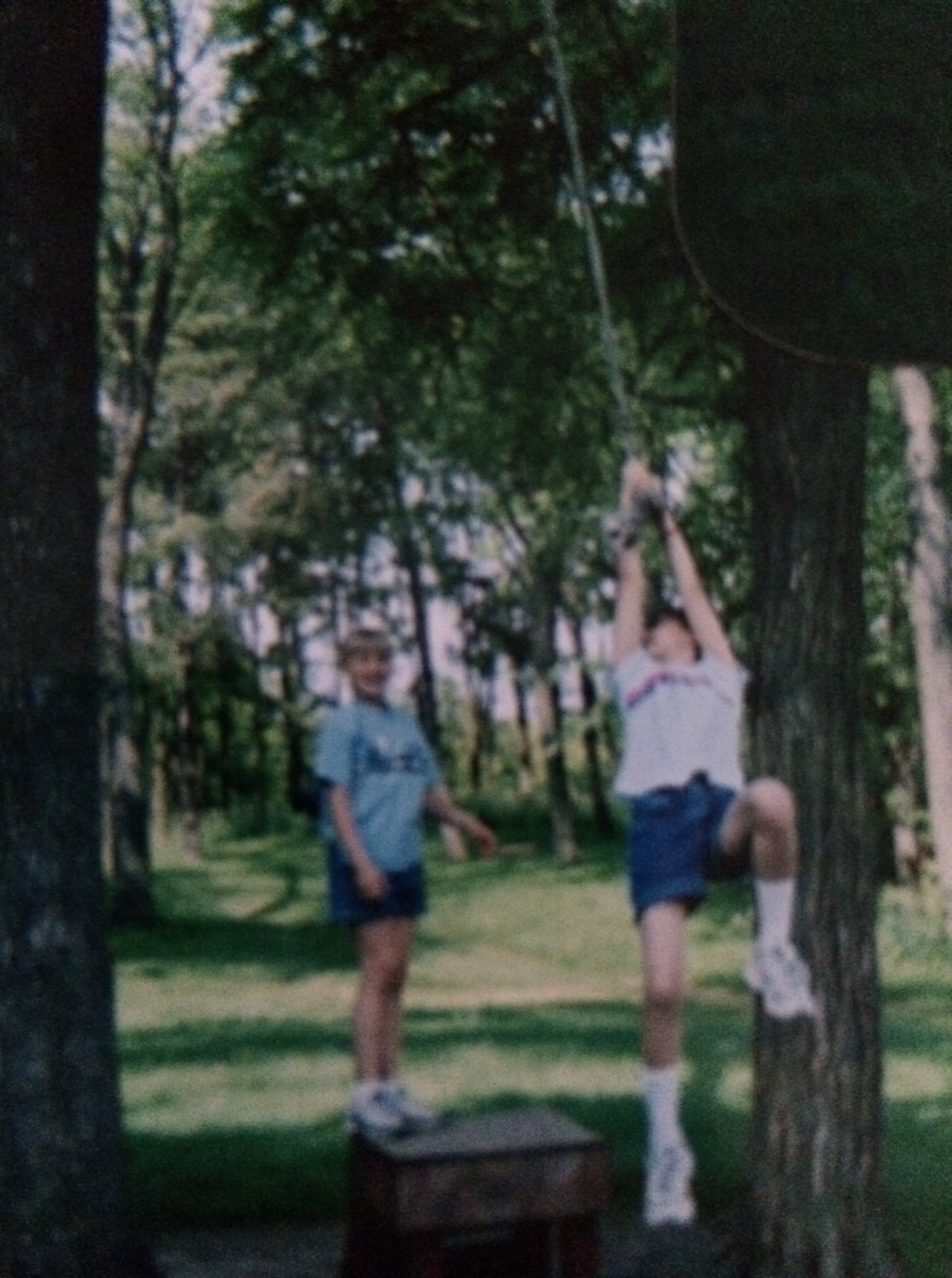 Here's me attempting to swing on this tree rope swing thing. Rachel's in the back, probably going, 'Oh dear God I really hope she doesn't kill herself.'