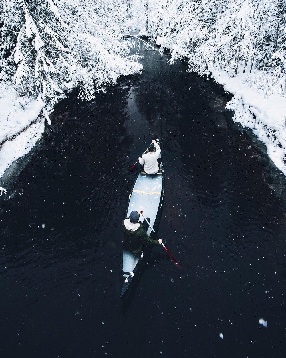 henrik.koskelo.winter.canoe.river.jpeg