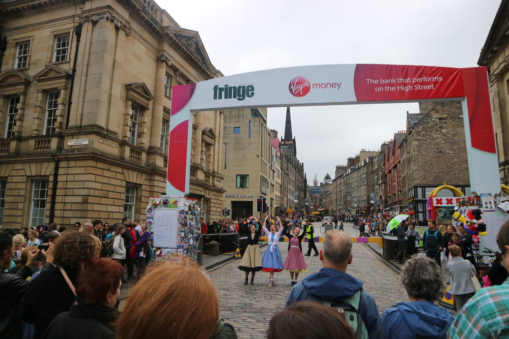 Ashleigh, Kara and Sally drawing in the crowds on the Royal Mile, Edinburgh  Photo credit: Sally White Creative