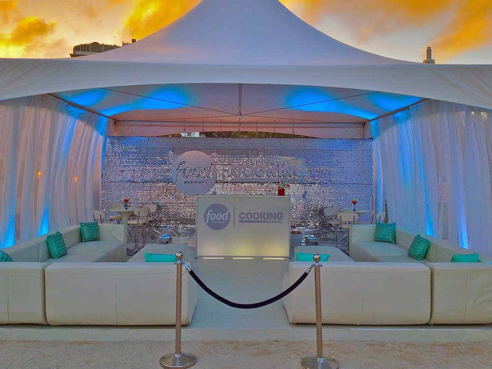 Branded food network tent with white lounge furniture.jpg