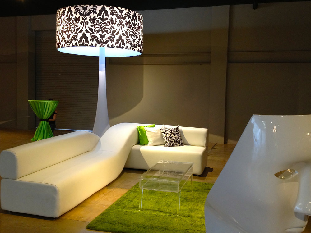 Tall freestanding lamps with white lounge sofa.jpg