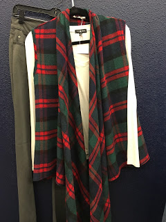 Plaid vest, long sleeve shirt paired  with a grey jean. Shop at  River Rose Clothing
