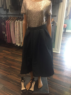 Gold sequin top paired with a black skirt.  Shop at  O'Neill House of Fashion