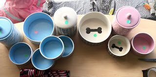 These bowls and treat jars from  Stinky Dawg Wash coordinate for an aesthetic that's just so  doggone cute.  Treat Jars: $22.99  Large Blue/Pink Bowls: $15.99  Small Blue/Pink Bowls: $9.99  Large Brown Bowl: $12.99  Small Brown Bowl: $7.99