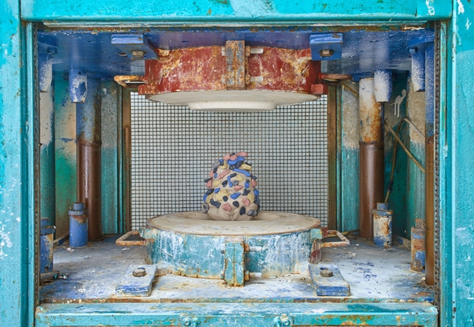 Hydraulic Press used to create their plates and cups