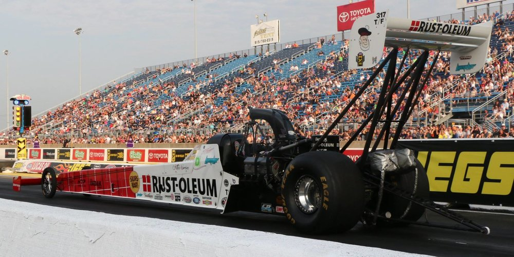 Zizzo puts some nitro into the Mr. Davids Foundation, launching it to the next level for their 10th Anniversary  JOLIET, IL (June 3, 2018) -- TJ Zizzo and Zizzo Racing spent the weekend competing for the top spot on the podium at the JEGS Route 66 NHRA Nationals, sending the Rust-Oleum dragster down the track at 326 MPH in 3.77 seconds. While race fans stood behind the rope looking on as the team worked to get the car ready to compete, something was unfolding quietly behind the scenes.  Just a day before the Rust-Oleum car made its first run down the track, TJ Zizzo accepted the Mr. Davids Foundation and Kittie's Warriors as sponsors, displaying the logos of both on his car. This came as a surprise to everyone except for Brian Schmidt, President of the Mr. Davids Foundation, who worked in conjunction with TJ to get this sponsorship to happen.  The unveiling of the sponsorship was a special moment to Kristina Russell and Sherri McKinney. Both are Mr. Davids Employees, cancer survivors and founders of Kittie's Warriors, a group within the Mr. Davids Foundation that focuses on supporting cancer patients and their families by raising funds through donations and sales.  The Mr. Davids Foundation holds its 10th Anniversary Challenge on August 25th in Itasca and has raised over $650,000 for its community partners since 2009.  To learn more, visit  www.mrdavidsfoundation.org ,  www.kittieswarriors.org  and  www.zizzoracing.com.